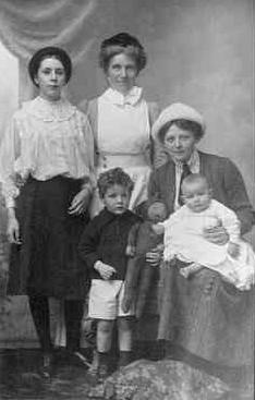 Ellen with Marjorie, Alaric and Clive on her lap, Nanny Finlay standing.
